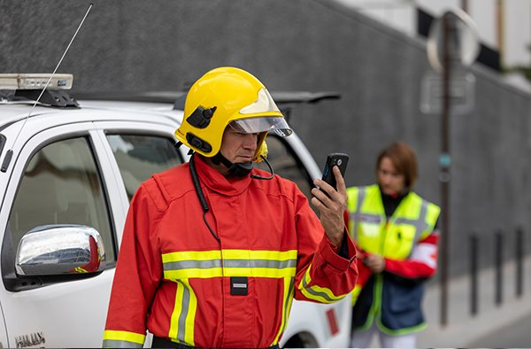 Fireman using a smartphone