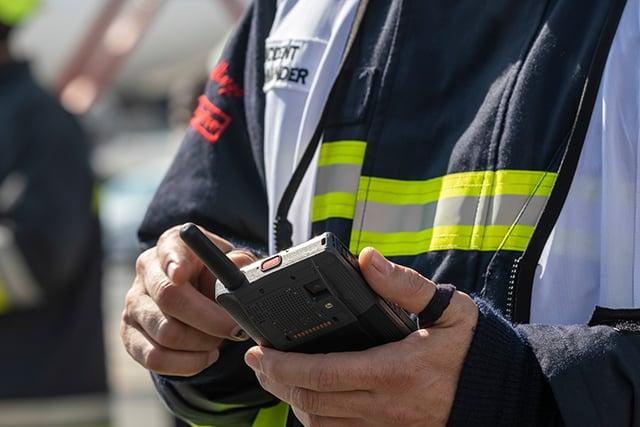 Tactilon-Dabat-in-firefighers-hands-at-Dubai-airport-640x420