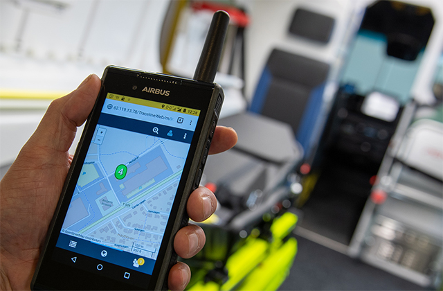 Tactilon Dabat hybrid device in hand with a map on the display