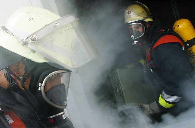 Firemen in a smoky building
