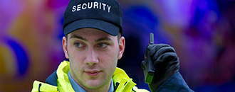 Security person with TH1n TETRA radio
