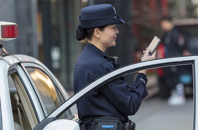 Police woman using a smartphone