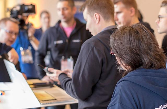 Critical App Challenge hackathon participants listening to briefing