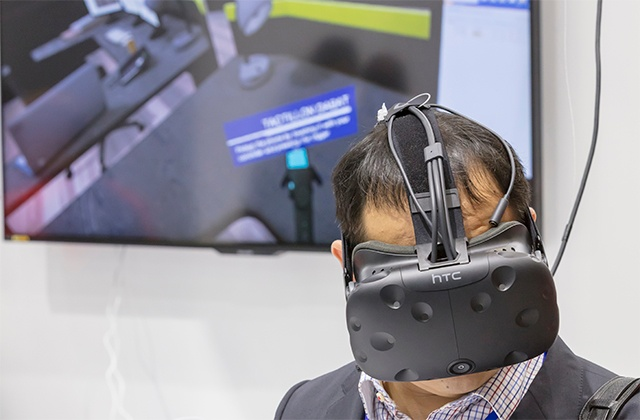 Man wearing VR glasses, experiencing a situation virtually