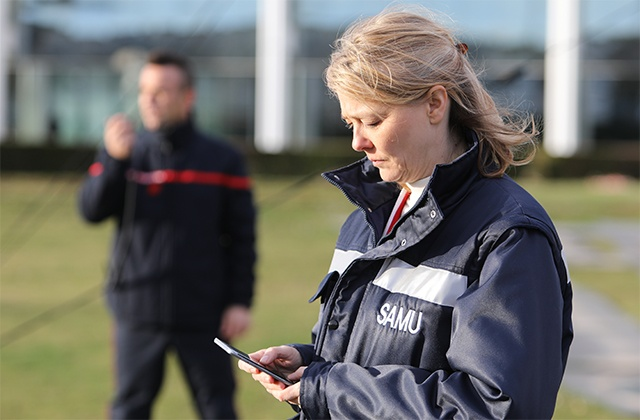 Medical professional uses a smartphone