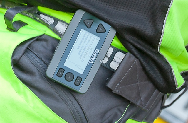 Active TETRA pager on a belt in a holder