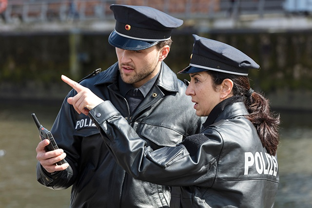 Two police view an image or video on Tactilon Dabat TETRA and LTE device