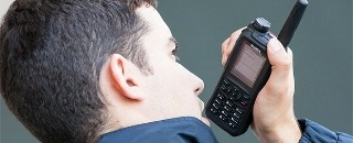Security-person-uses-TH9-TETRA-radio-330x130