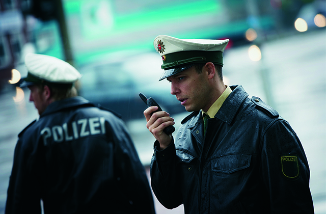 Police officers using an Airbus TETRA radio