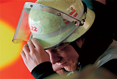 Fireman-touches-his-helmet-237x160