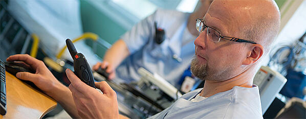 Medical-professional-uses-THR880i-TETRA-radio-680x265