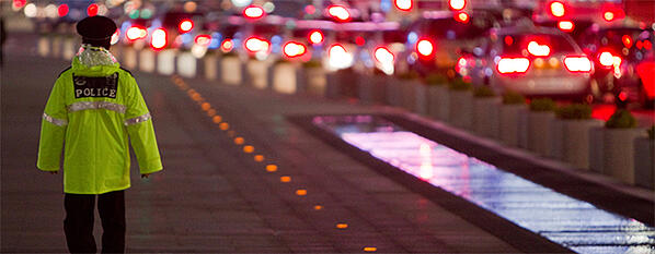 Police-walking-on-street-at-night-680x265