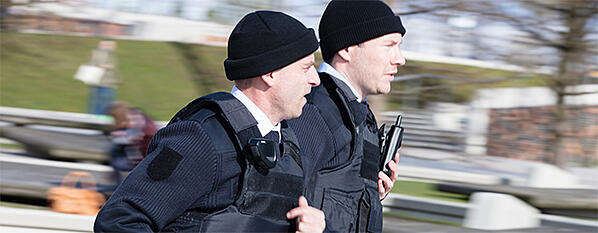 Two-security-professionals-running-and-Tactilon-Dabat-680x265