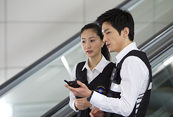 Security persons holding a TETRA radio
