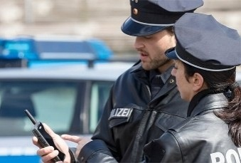 Two-police-officers-looking-at-Tactilon-Dabat-display-339x229