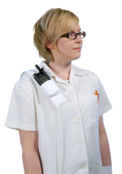 A nurse carrying a TH1n TETRA radio