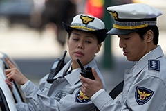 Two police officers with TETRA radios