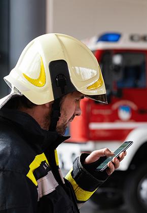A fireman using a smartphone